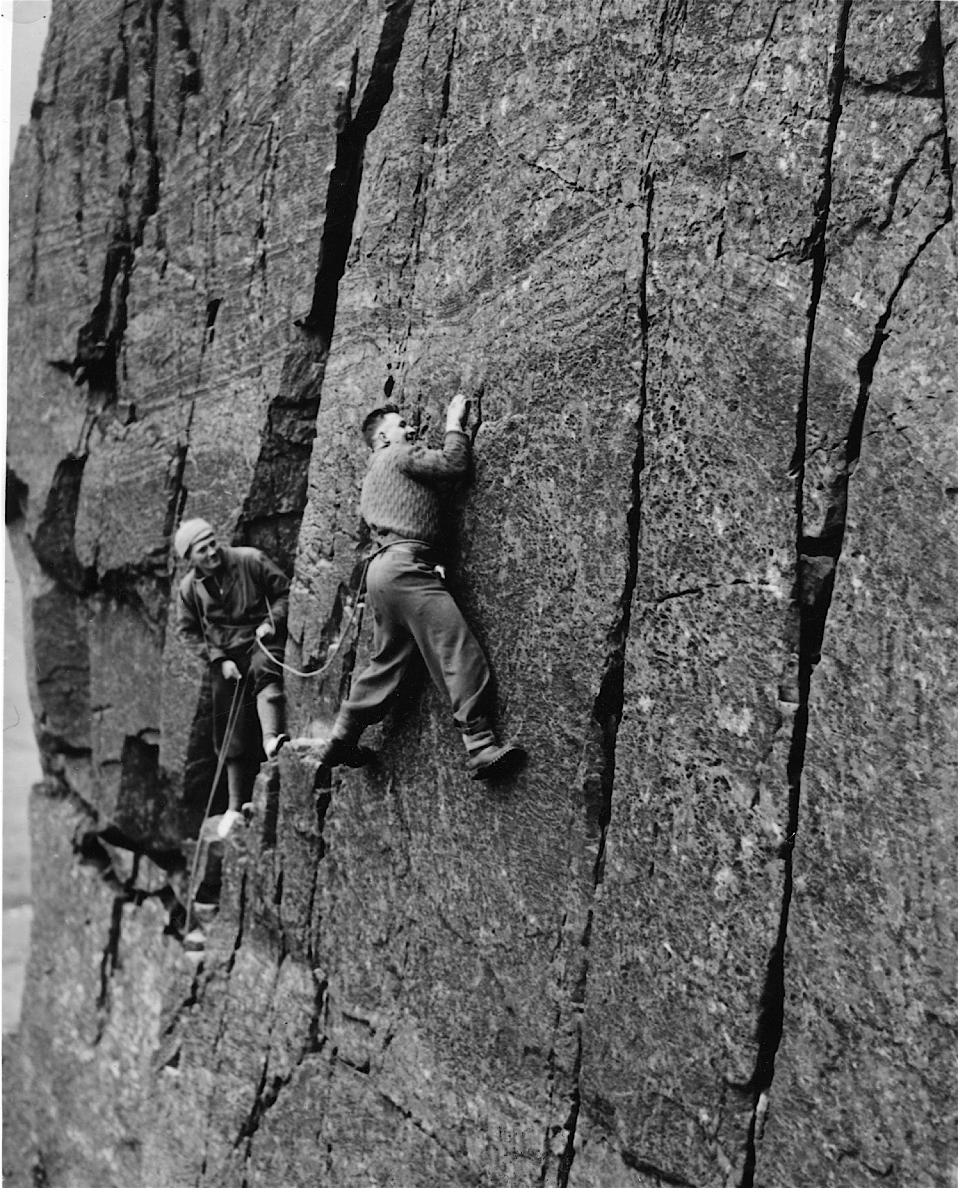 Jim Birkett, centre, with Len Muscroft, left, and Charlie Wilson, right, on top after their first ascent of Overhanging Bastion up the North Face of Castle Rock. It's now graded HVS 5a and at the time the climb caused a sensation because it was much bolder and harder than any other rock climb in Britain. The headlines in the press read 'Lakeland Everest Conquered'. It's still a considerable undertaking even with today's modern equipment and footwear.