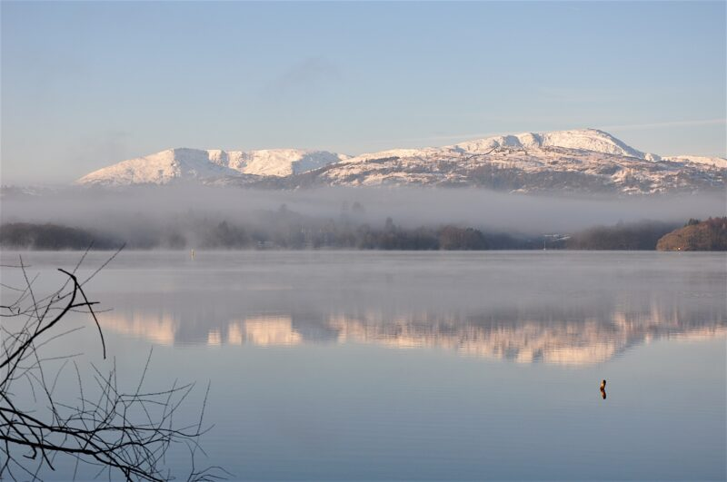 'Southern Fells over Windermere'. Rising from the early morning mists stand the king and the queen of the Southern Fells – powerful Coniston Old Man to the left and sublime Wetherlam to the right.