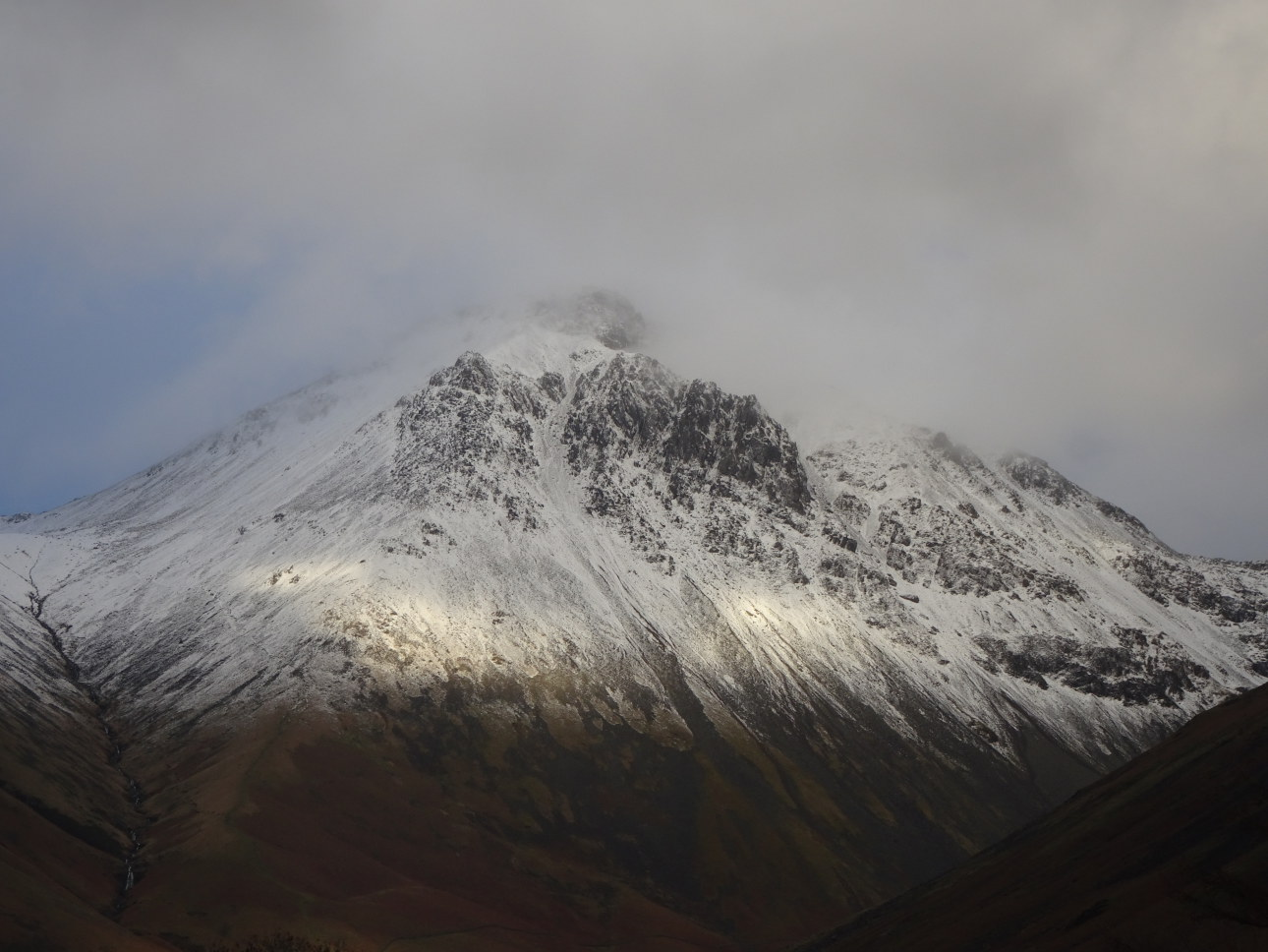 The black rocks of The Napes are revealed as the clouds rise from Great Gable.  Taken 22/1/20 at 4:36pm.