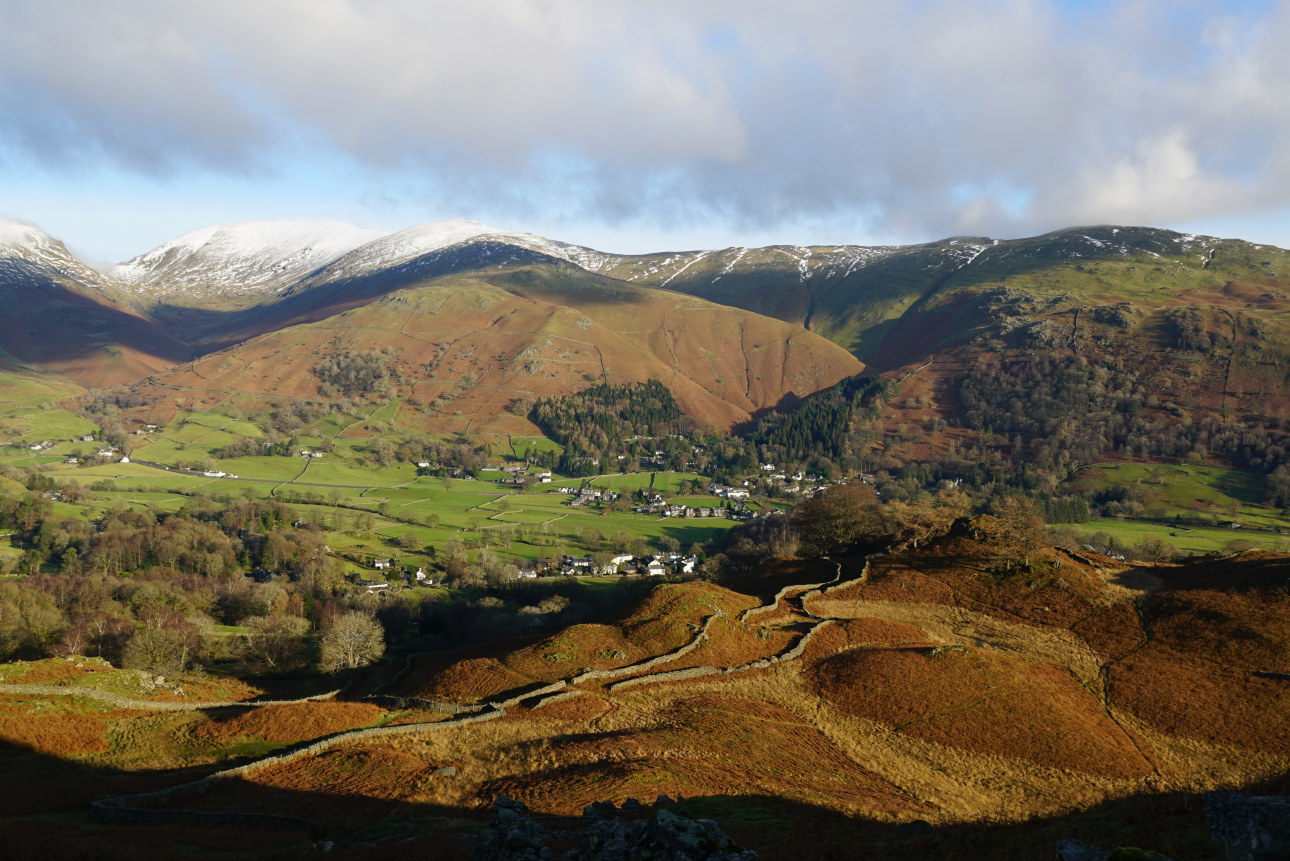 """Looking to Fairfield over the vale of Grasmere. The parallel stone walls over the high shoulder which runs above Allan Bank are known as an """"Ootgang"""" or  """"Ingang""""  and were once for keeping the sheep from farm to fell, or vice versa , from the field enclosures. These seen here lead nowhere now,  ending  in the once-private grounds of Allan Bank constructed at the beginning of the 19th century. Who knows when these wall acted as a sheep highway? Quite likely they were originally  built in the 12th century. Still standing - so quite a job then! Taken on 7/12/20 at 12:39 pm."""