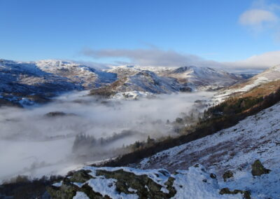The mist still hugs the vale of Grasmere but it's thinning now. Taken at 1:238pm.