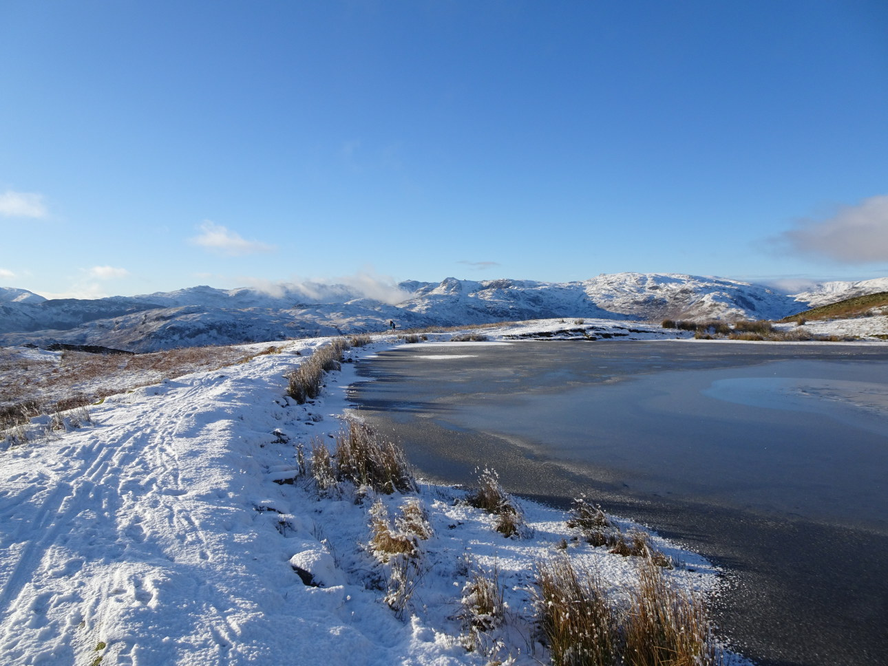 Alcock Tarn with Harrison Stickle seen centrally beyond. Taken at 2:07pm.
